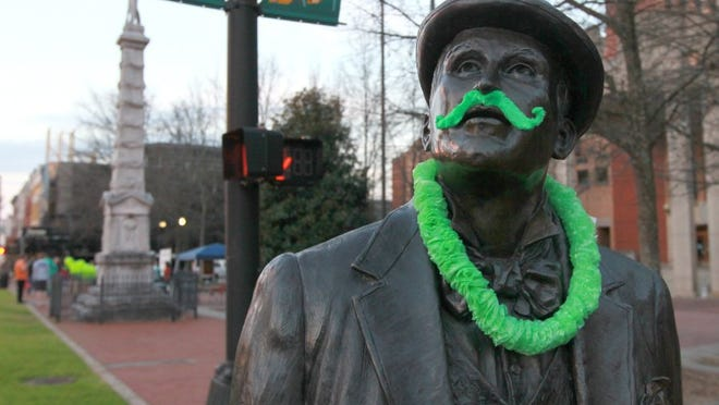 The William Whitner statue is decorated for St. Patrick's Day in downtown Anderson.