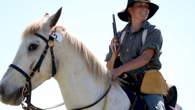 Adam Sauceda/Standard-Times Courtney De Long prepares to make her pistol run Friday at Fort Concho.