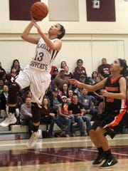 Tularosa's Cassie Vickery attempts a lay-up. Vickery tallied 20 points in the District 3-3A championship. Tularosa went on to defeat Lordsburg 71-47 on Friday night.