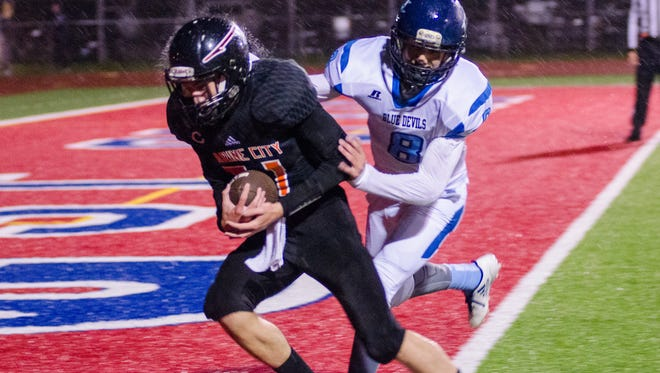 Richmond's Tyler Bartolomucci chases Marine City's William Patsalis as he runs the ball in for a touchdown during the MHSAA Division 5 playoff football game at East China Stadium Oct. 26.