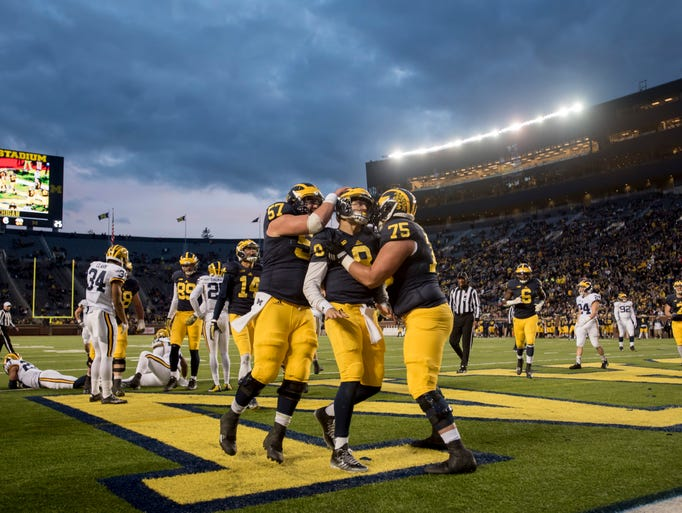 From left, Michigan offensive lineman Patrick Kugler,