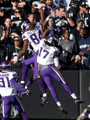 Minnesota Vikings' Cordarrelle Patterson (84) celebrates with teammates Jarius Wright (17) and Jerick McKinnon after returning a kickoff for a touchdown during the first half of an NFL football game against the Oakland Raiders in Oakland, Calif., Sunday, Nov. 15, 2015. (AP Photo/Beck Diefenbach)