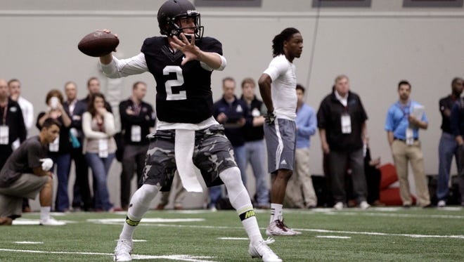 Texas A&M quarterback Johnny Manziel passes the ball during a drill at pro day for NFL football representativesin College Station, Texas, on Thursday.