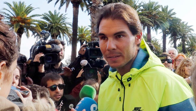 Rafael Nadal talks to journalists as he leaves the hospital after appendicitis surgery in Barcelona on Nov.5.