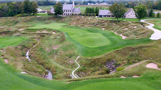 """Hole No. 18 at Whistling Straits golf course in Haven, Mich., sits barren of infrastructure needed to host September's Ryder Cup. A Ryder Cup spokesman told the Journal Sentinel that """"the 2020 Ryder Cup remains as scheduled"""" despite the COVID-19 pandemic."""
