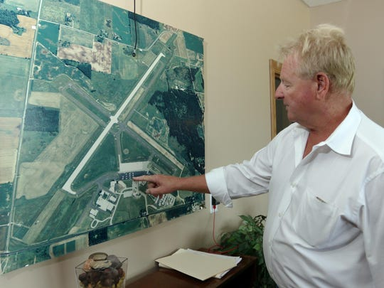 Ron Burrows, owner of Burrows Aviation, points out an area that was rebuilt at the airport Monday, Aug. 31, at Memorial Airport in Sheboygan Falls.