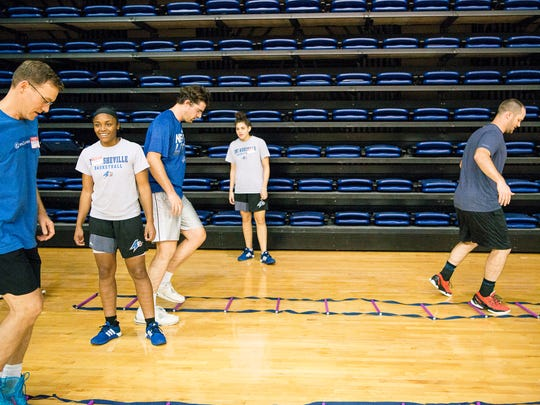 The UNC Asheville women's basketball team leads exercises