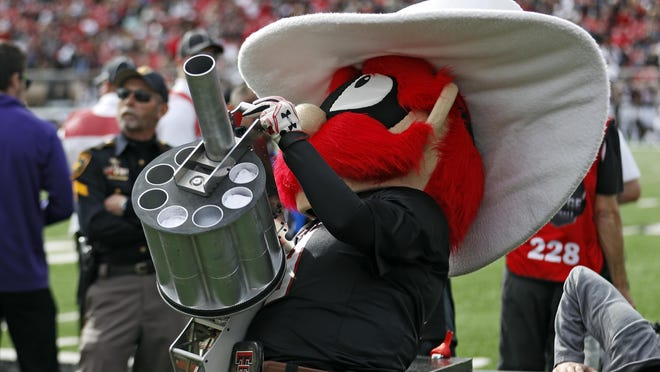 Raider Red shoots t-shirts into the crowd during the second half of an NCAA college football game against Texas Tech, Saturday, Nov. 16, 2019, in Lubbock, Texas.
