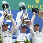 Nico Hulkenberg, Nick Tandy and Earl Bamber celebrate after winning the 24 Hours of Le Mans on June 14 in France. Tandy and Bamber are among those competing in the Sahlen's Six Hours of The Glen.