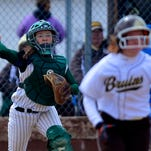 CMR catcher Katie Huisman throws out the Helena Capital batter after fielding a bunt during the Softball Jamboree on Saturday.
