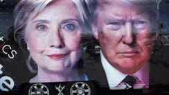 A TV van with pictures of Hillary Clinton and Donald