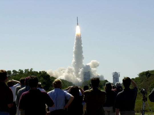 At 11:02 a.m. EDT on April 7, 2001, crowds watched a Boeing Delta II rocket lift off from Cape Canaveral Air Force Station carrying NASA's 2001 Mars Odyssey spacecraft into space on its seven-month journey to Mars.
