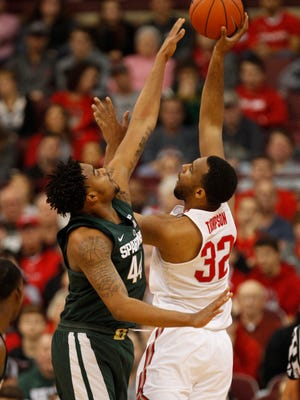 Ohio State center Trevor Thompson shoots against Michigan State forward Nick Ward during the first half  in Columbus, Ohio, Sunday, Jan. 15, 2017.