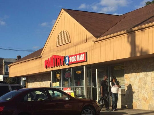 Customers on Tuesday leave a Woodlynne convenience store where a man was fatally beaten last month.