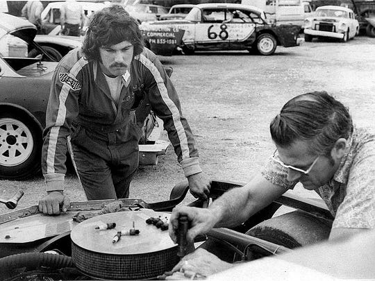 Terry Labonte watches a last-minute tuneup on his car before heading out to the track at Corpus Christi Speedway in March 1973.