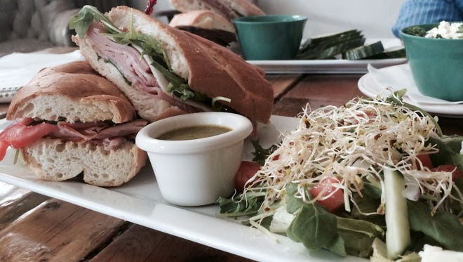 The H&M sandwich at Craft & Social, 305 E. Franklin, includes Black Forest Ham and Manchego cheese. It is served with a side Craft Salad.