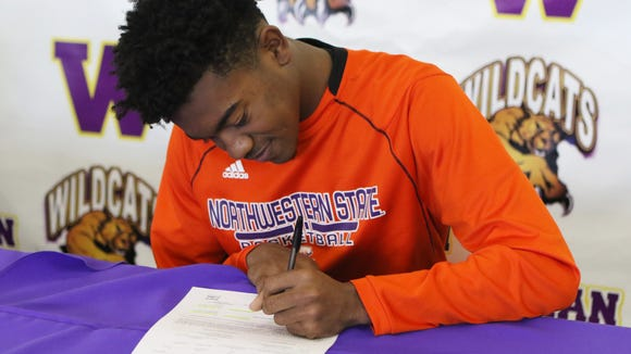 Wossman senior C.J. Jones signs a national letter of intent signifying his plans to play basketball at Northwestern State next year on Wednesday, Nov. 9, 2016.