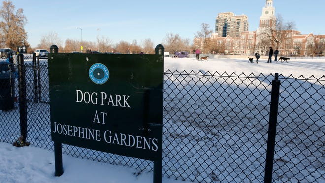 In this Saturday, Dec. 27, 2014 photo, a sign marks the lot for dogs to run off-leash, in east Denver, but where a 60,000-square-foot public recreational center will be built with the help of tax dollars raised from legal marijuana sales in the Centennial State since Jan. 1, 2014.