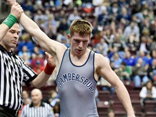Chambersburg's Garrett Kyner leaves the mat after winning