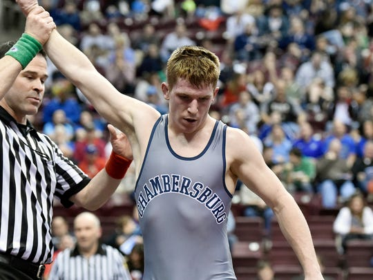 Chambersburg's Garrett Kyner leaves the mat after winning his final bout, a 138-pound seventh-place match in the PIAA Class AAA finals Saturday. Kyner defeated Cathedral Prep's Carter Starocci 7-4 with a late flurry of points.