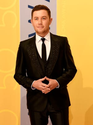 Scotty McCreery arrives on the red carpet at the 2016 CMA Awards on Nov. 2, 2016, in Nashville.