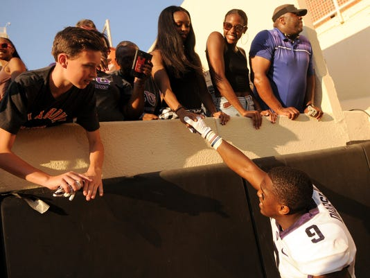 TCU wide receiver John Diarse celebrates with fans after the game in Stillwater, Okla., Saturday, Sept. 23, 2017. Diarse scored 1 touchdown and had 40 yards receiving in the 44-31 TCU win over Oklahoma St. (AP Photo/Brody Schmidt)