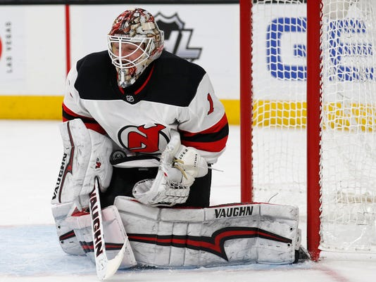 New Jersey Devils goaltender Keith Kinkaid makes a save against the Vegas Golden Knights during the second period of an NHL hockey game Wednesday, March 14, 2018, in Las Vegas. (AP Photo/John Locher)