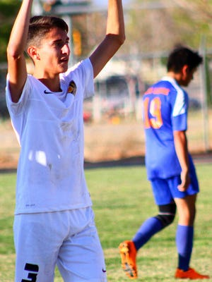 Alamogordo's Keith Wilder, left, celebrates his team's 2-1 victory over Los Lunas during the first round of the Class 5A state playoffs Saturday afternoon at the Riner Steinoff Soccerplex.