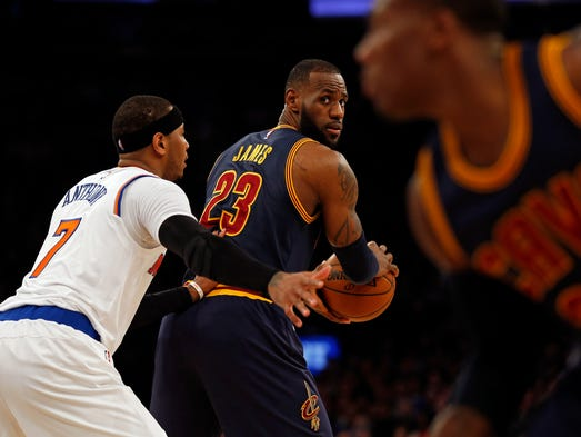 Cleveland Cavaliers forward LeBron James looks to pass