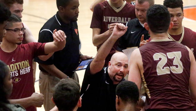 Riverdale boys basketball coach Michael Voss talks to his team during a timeout in a recent game. Voss and the Warriors will play Northeast in the AAA state quarterfinals next Wednesday at MTSU.