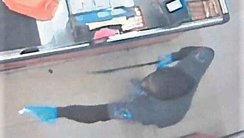 Robber with a machete threatens employees on Feb.10 at Zeke's Pueblo Mexicano Supermarket.
