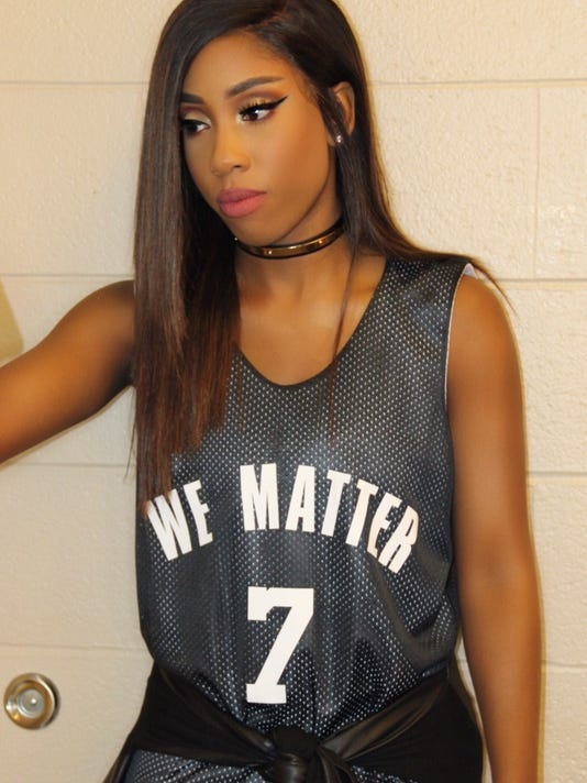"""This photo provided by Atlantic Records shows Sevyn Streeter at an arena for an NBA basketball game between the Philadelphia 76ers and Oklahoma City Thunder in Philadelphia on Wednesday, Oct. 26, 2016. Philadelphia 76ers national anthem singer Streeter said she was told by the team she could not perform because of her """"We Matter"""" jersey. (Sevyn Streeter/Atlantic Records via AP)"""