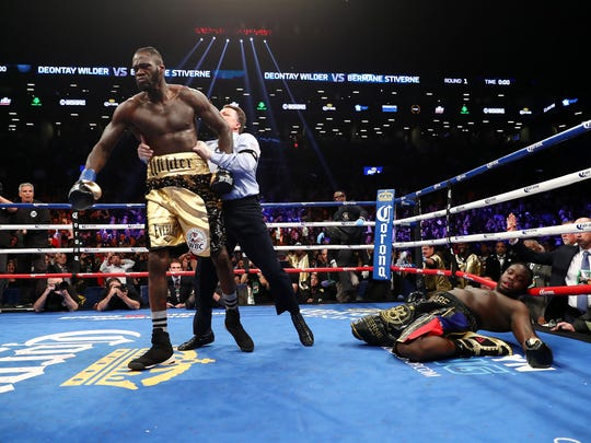 NEW YORK, NY - NOVEMBER 04: (One of a set of 117 sports images)  Deontay Wilder knocks out Bermane Stiverne in the first round during their rematch for Wilder's WBC heavyweight title at the Barclays Center on November 4, 2017 in the Brooklyn Borough of  New York City.  (Photo by Al Bello/Getty Images) ORG XMIT: 775027894 ORIG FILE ID: 890349810