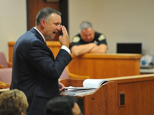 Chief Assistant State Attorney Tom Bakkedahl gestures while arguing a point with Defense Attorney Katie Alonzo (not pictured) while questioning witness Liana Mendoza, a psychiatrist that use to work at the St. Lucie County Jail, during the fourth day of Tyler Hadley's sentencing hearing on Thursday, March 13, 2014, at the St. Lucie County Courthouse in Fort Pierce.