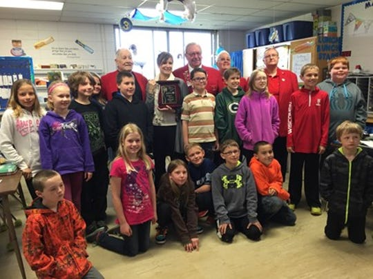 Stephanie Kinscher with her class and representatives from Two Rivers Elks Club.