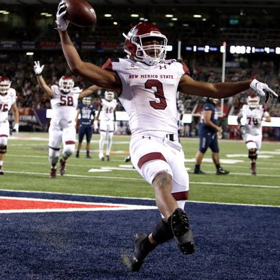 New Mexico State running back Larry Rose III (3) reacts