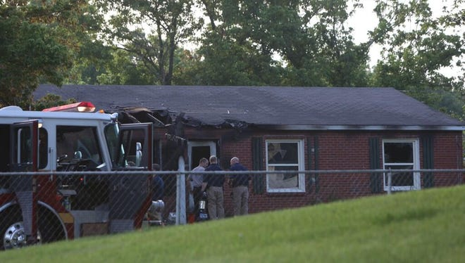 Crews still on the scene of an overnight fire that killed a woman on Dunraven Drive in Colerain Township