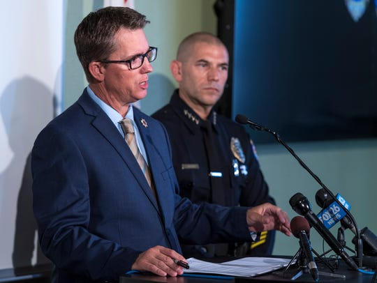 Tulare County District Attorney Tim Ward, left, and