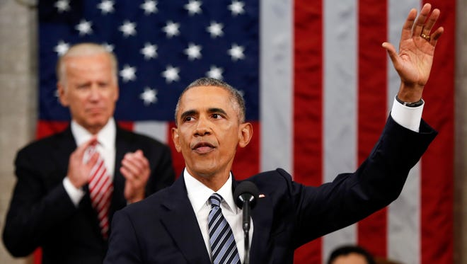 President Barack Obama waves at the conclusion of his State of the Union address to a joint session of Congress on Tuesday on Capitol Hill in Washington, D.C.