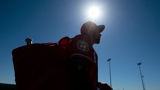 Cincinnati Reds center fielder Billy Hamilton (6) carries his gear to batting practice at the Reds Player Development Complex in Goodyear, Ariz., on Wednesday, Feb. 24, 2016.