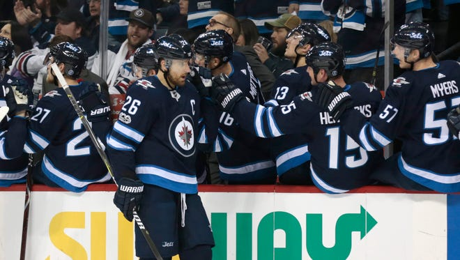 Winnipeg Jets right wing Blake Wheeler (26) celebrates his third goal in the first period.