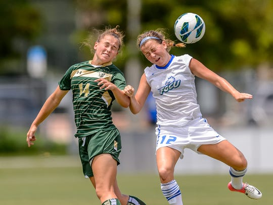 FGCU's Ally Kasun and USF's Alexandra Myers vie for a header during a 2013 match at FGCU.