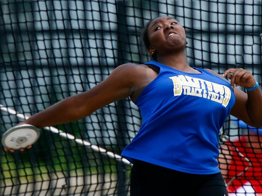 Brentwood's Kathrine Coffey throws the discus as she