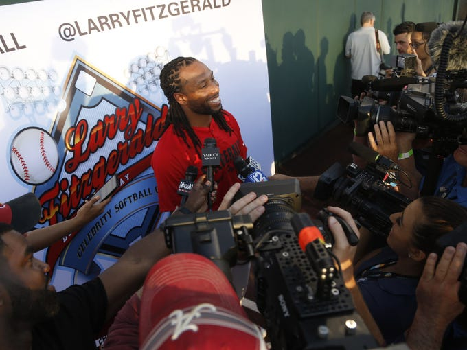 Larry Fitzgerald answers questions from the press before