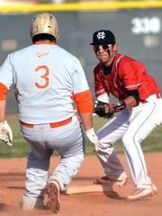 Centennial second baseman Chris Ordonez  gets ready to tag an Artesia runner during Tuesday's game at Field of Dreams.