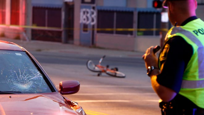 A bicyclist was struck and critically injured in Over-the-Rhine on Sunday. Police said the driver fled the scene on foot leaving his car behind.
