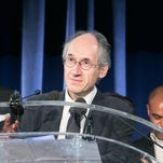 Charlie Hebdo Editor-in-Chief Gerard Biard accepts the Freedom of Expression Courage Award  as Alain Mabanckou,, left, looks on during the 2015 PEN Gala at the American Museum of Natural History in New York on May 5, 2015.