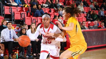 Danaejah Grant (dribbling) is tearing it up for St. John's.