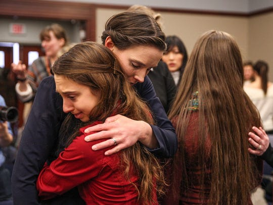 Rachael Denhollander receives a hug after delivering her impact statement in front of former USA Gymnastics doctor Larry Nassar inside Ingham County Circuit Court in Lansing, Mich., Wednesday, Jan. 24, 2018.