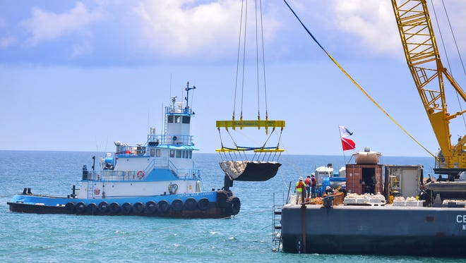 A contractor for the U.S. Army Corps of Engineers has begun installing artificial reefs offshore at Pelican Beach Park. The reefs are concrete mats embedded with coquina rock being installed approximately 1000 feet offshore in 15 feet of water at 10 sites from Satellite Beach to Indialantic.